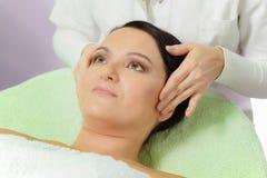 Woman Enjoying a Facial Massage Royalty Free Stock Photo