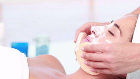 Woman enjoying a facial treatment stock video