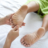Woman enjoying foot reflexology Royalty Free Stock Photo
