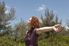 Woman enjoying freedom and nature stock photo