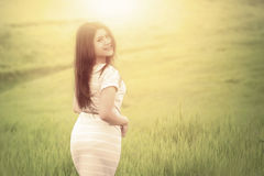 Woman enjoying freedom and walk at field Royalty Free Stock Images