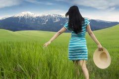 Woman enjoying freedom and walking at field Stock Photos