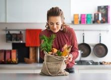 Woman enjoying freshness of local market purchases. Young housewife enjoying freshness of local market purchases Stock Images