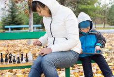 Woman enjoying a game of chess outdoors Stock Photo
