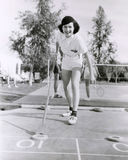 Woman enjoying a game of shuffleboard Royalty Free Stock Images