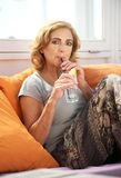 Woman enjoying a glass of water at outdoors restaurant Royalty Free Stock Image