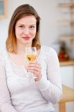 Woman enjoying a glass of wine Royalty Free Stock Images
