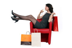 Woman enjoying a glass of wine. During a shopping trip Royalty Free Stock Photo