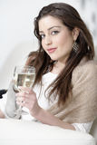 Woman enjoying a glass of wine Royalty Free Stock Image