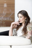 Woman enjoying a glass of wine Royalty Free Stock Photos