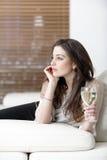 Woman enjoying a glass of wine Stock Image