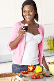 Woman Enjoying Glass Of Wine In Kitchen Stock Images