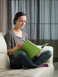 Woman enjoying a good book Stock Photography