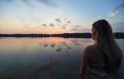 Woman enjoying the great outdoors watching a beautiful sunset Stock Image
