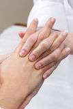 Woman enjoying hand massage at beauty spa Royalty Free Stock Photo