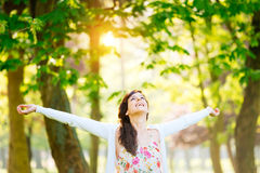 Woman enjoying happiness and hope on spring. Blissful woman enjoying freedom and life in park on spring Stock Images