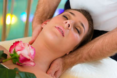 Woman enjoying head massage in a spa Stock Image