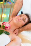 Woman enjoying head massage in a spa Stock Photography