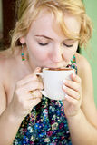 Woman enjoying her chocolate or coffee Royalty Free Stock Images