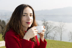 Woman enjoying her coffee outdoors Stock Photo