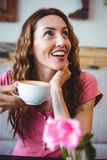 Woman enjoying her cup of coffee Stock Photo