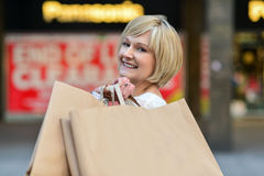 Woman enjoying her day out, shopping. Pretty charming woman with shopping bags Stock Images