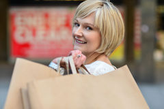 Woman enjoying her day out, shopping. Pretty charming woman with shopping bags Stock Photography