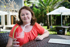 Woman enjoying her fresh watermelon juice Stock Photos