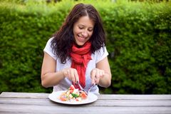 Woman Enjoying Her Lunch Alone Royalty Free Stock Photo