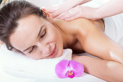 Woman enjoying her massage Stock Images
