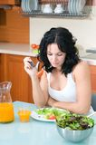 Woman enjoying her salad Royalty Free Stock Image