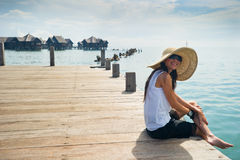 Woman enjoying her vacation at the bay Stock Image