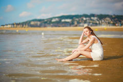 Woman enjoying her vacation by ocean or sea Royalty Free Stock Photos