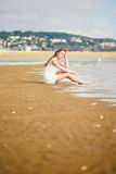 Woman enjoying her vacation by ocean or sea Royalty Free Stock Photo
