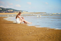 Woman enjoying her vacation by ocean or sea Royalty Free Stock Image