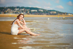 Woman enjoying her vacation by ocean or sea Stock Photography