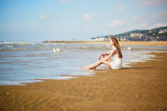 Woman enjoying her vacation by ocean or sea Stock Photo