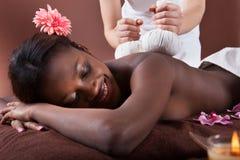 Woman Enjoying Herbal Massage At Spa Stock Image