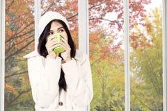 Woman enjoying hot drink in autumn Royalty Free Stock Photo