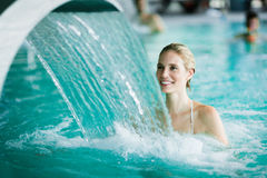 Woman enjoying hydrotherapy in spa pool. Woman enjoying hydrotherapy and water stream in spa pool Royalty Free Stock Photography