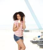 Woman enjoying ice cream at the beach Stock Image