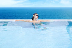 Woman enjoying infinity pool 1 Royalty Free Stock Image