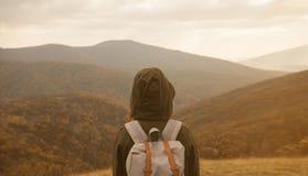 Woman enjoying landscape of autumn mountains Stock Images