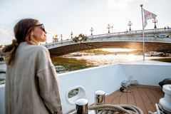 Woman enjoying landscape view on Paris city from the boat royalty free stock photography