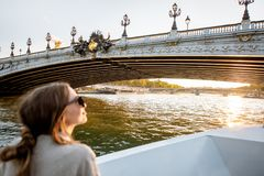 Woman enjoying landscape view on Paris city from the boat stock photos