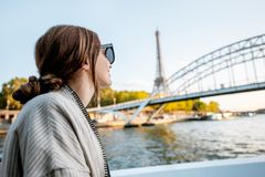 Woman enjoying landscape view on Paris city from the boat stock image