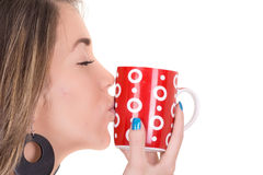 Woman enjoying a large cup of freshly brewed hot Royalty Free Stock Images