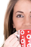Woman enjoying a large cup of freshly brewed hot Royalty Free Stock Photos