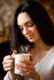 Woman enjoying latte coffee in caf Stock Photo