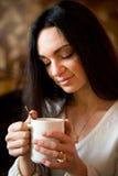 Woman enjoying latte coffee in caf Stock Photo